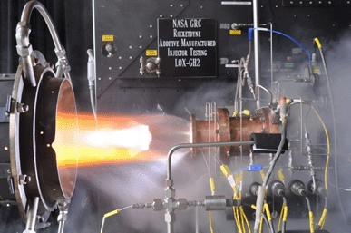 Liquid oxygen/gaseous hydrogen rocket injector assembly built using additive manufacturing technology is hot-fire tested at NASA Glenn Research Center's Rocket Combustion Laboratory in Cleveland
