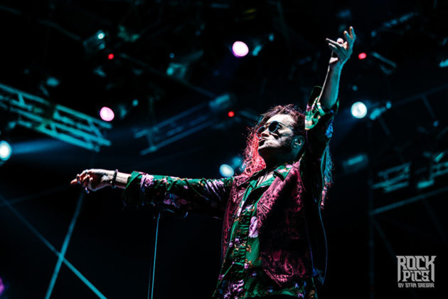 Picture of Glenn Hughes with concert pictures by Stan Srebar