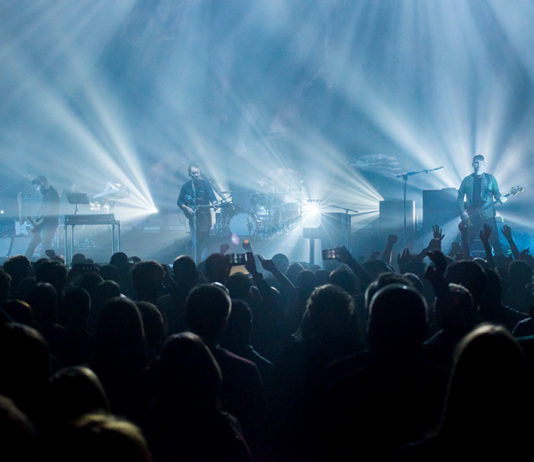 Picture of Editors in concert with Indie rock concert photography by Norbert Burkowski