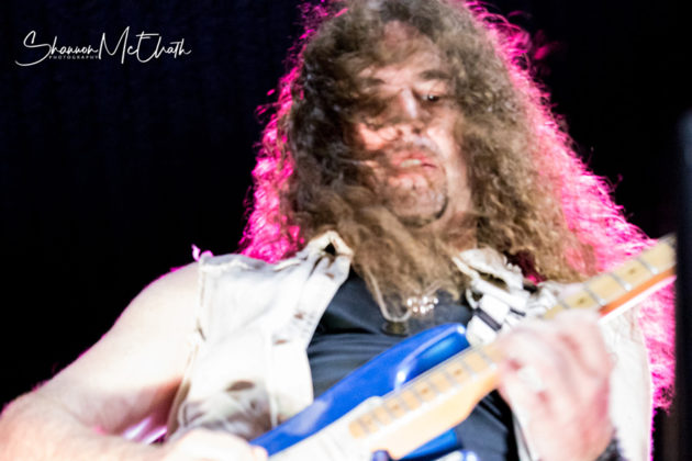 Picture of Winger in concert by Texas music photographer Shannon McElrath