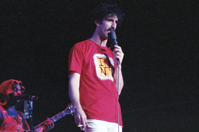 Picture of Frank Zappa in concert with photography by Bill O'Leary