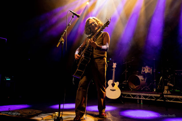 Picture of Miles Hunt in concert with photography by Naomi Dryden-Smith