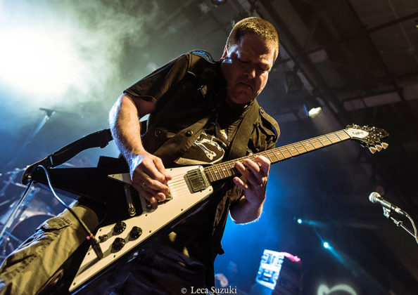 Picture of the thrash metal band Nuclear Assault in concert with photography by Leca Suzuki