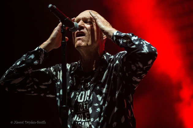 Picture of the rock band Midnight Oil in concert taken by music photographer Naomi Dryden-Smith