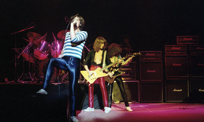 Picture of the rock band Def Leppard with original line up in concert taken by Bill O'Leary