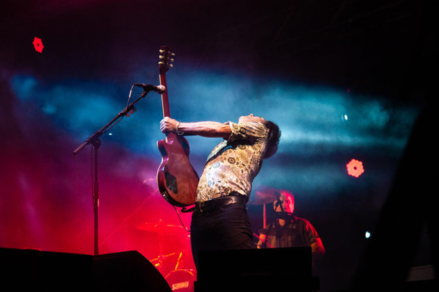 Picture of The Hoodoo Gurus in concert taken by Brittany Long