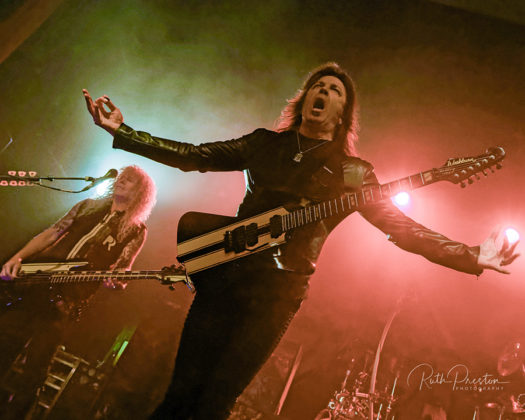Picture of the heavy metal band Stryper in concert taken by Ruth Preston