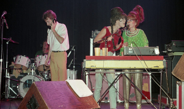 Picture of the band The B-52s in concert taken by Bill O'Leary