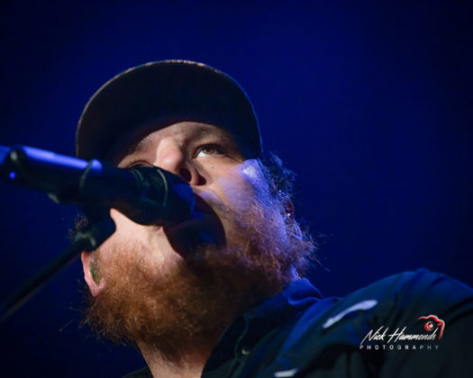 Picture of Luke Combs in concert taken by Nick Hammonds