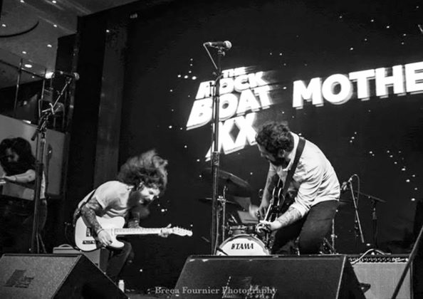 Picture of the band Motherfolk in concert taken by Breea Fournier