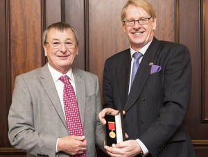 Past president Peter Hoyle (left) receives his Distinguished Service Award from B&ES chief executive Roderick Pettigrew