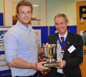 B&ES president Bruce Bisset (right) presents the David Kettles Cup to Scottish Craft Apprentice of the Year Tom Gregory of Prospero Facilities Services.