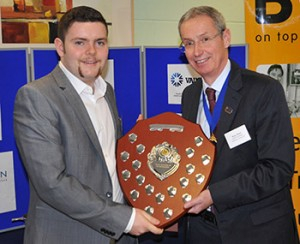 B&ES president Bruce Bisset presenting Jamie Peffers of B&ES member C&M Environmental, Glasgow, with the Scottish RAC Apprentice of the Year Award