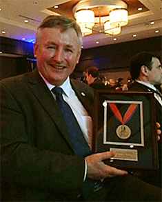 Dr Andy Pearson with the Award