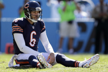 Oct. 5, 2014. Chicago Bears' Jay Cutler (6) sits on the ground after being hit after a pass against the Carolina Panthers during the second half of an NFL football game in Charlotte, N.C. Cutler, who was pegged as the Bears' savior and instead paid the price for their failure to upgrade the talent around him. (AP Photo/Bob Leverone, File) ORG XMIT: NY159