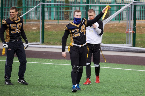 Spartans defender Andrey Ignatiev show captured flag