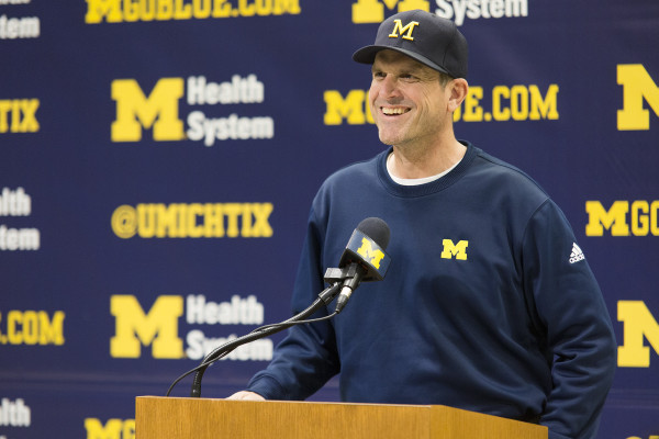 Michigan football coach Jim Harbaugh answers questions following the first day of spring practice at a press conference at Schembechler Hall Tuesday. (ALLISON FARRAND / Daily)