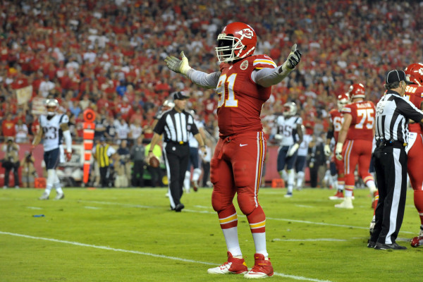 Sep 29, 2014; Kansas City, MO, USA; Kansas City Chiefs outside linebacker Tamba Hali (91) celebrates after the Chiefs recovered a fumble during the second half against the New England Patriots  at Arrowhead Stadium. The Chiefs won 41-14. Mandatory Credit: Denny Medley-USA TODAY Sports ORG XMIT: USATSI-180132 ORIG FILE ID:  20140929_ajw_sm8_460.JPG
