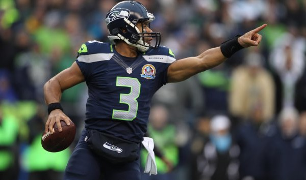 SEATTLE, WA - DECEMBER 09:  Russell Wilson #3 of the Seattle Seahawks points downfield against the Arizona Cardinals in the first quarter at CenturyLink Field on December 9, 2012 in Seattle, Washington.  (Photo by Kevin Casey/Getty Images)