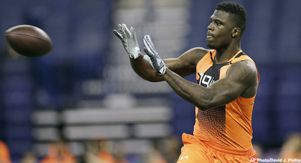 Missouri wide receiver Dorial Green-Beckham runs a drill at the NFL football scouting combine in Indianapolis, Saturday, Feb. 21, 2015. (AP Photo/David J. Phillip)