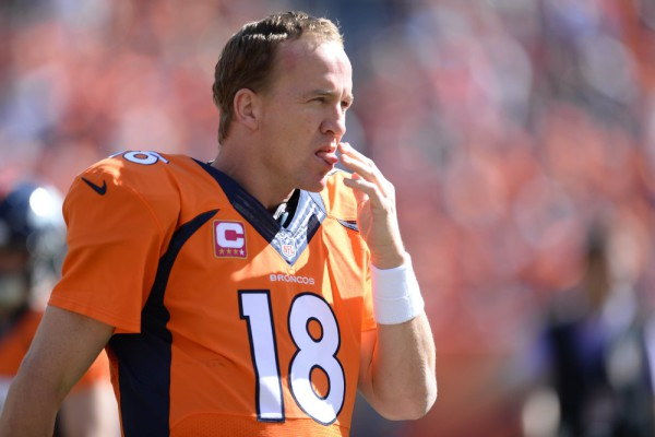 Oct 5, 2014; Denver, CO, USA; Denver Broncos quarterback Peyton Manning (18) licks his fingers in the first quarter against the Arizona Cardinals at Sports Authority Field at Mile High. Mandatory Credit: Ron Chenoy-USA TODAY Sports ORG XMIT: USATSI-180154 ORIG FILE ID: 20141005_krj_ac4_0072.JPG