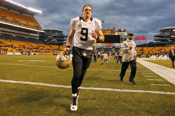 New Orleans Saints quarterback Drew Brees (9) runs off the field after a 35-32 win over the Pittsburgh Steelers in an NFL football game at Heinz Field in Pittsburgh, Sunday, Nov. 30, 2014. (AP Photo/Gene J. Puskar) ORG XMIT: PAGP