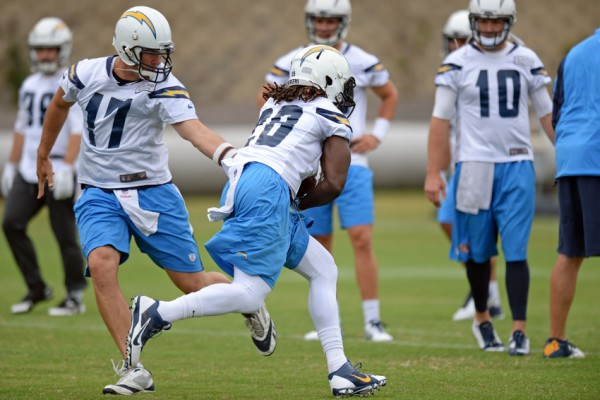 May 26, 2015; San Diego, CA, USA; (EDITORS NOTE: caption correction) San Diego Chargers quarterback Philip Rivers (17) hands the ball off to running back Melvin Gordon (28) during organized team activities at Charger Park. Mandatory Credit: Jake Roth-USA TODAY Sports