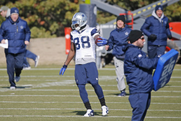 Dallas Cowboys wide receiver Dez Bryant (88) cuts between coaches as he works during drills at Dallas Cowboys practice at Valley Ranch on Wednesday, January 7, 2015.  (Louis DeLuca/The Dallas Morning News)