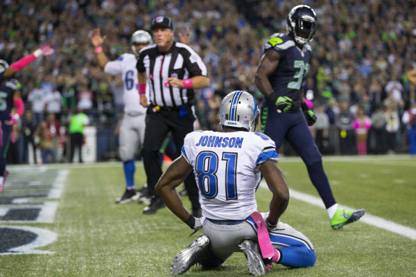Seahawks safety Kam Chancellor walks past dejected Lions wide receiver Calvin Johnson after Chancellor kept him from scoring in the last few minutes in the fourth quarter during Monday Night Football at CenturyLink Field, Oct. 5, 2015.  (Dean Rutz / The Seattle Times)