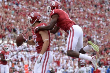 Sep 19, 2015; Norman, OK, USA; Oklahoma Sooners tight end Mark Andrews (81) and Oklahoma Sooners wide receiver Jarvis Baxter (1) celebrate in the endzone after scoring a touchdown against the Tulsa Golden Hurricane during the third quarter at Gaylord Family - Oklahoma Memorial Stadium. Mandatory Credit: Mark D. Smith-USA TODAY Sports