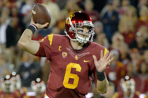 LOS ANGELES, CA - NOVEMBER 13:  Cody Kessler of the USC Trojans rolls out of the pocket to make a pass against the California Golden Bears during the first quarter at Los Angeles Memorial Coliseum on November 13, 2014 in Los Angeles, California.  (Photo by Harry How/Getty Images) ** OUTS - ELSENT, FPG - OUTS * NM, PH, VA if sourced by CT, LA or MoD **