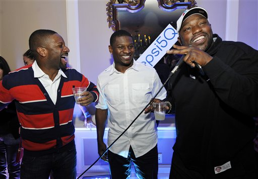 IMAGE DISTRIBUTED FOR PEPSI - D.J. Irie, left, laughs with NFL stars  LaDainian Tomlinson and Warren Sapp, right, at the Pepsi 5th Quarter in the French Quarter Post Super Bowl Party, on Sunday, Feb. 3, 2013, in New Orleans. (Photo by Jack Dempsey/Invision for Pepsi/AP Images)