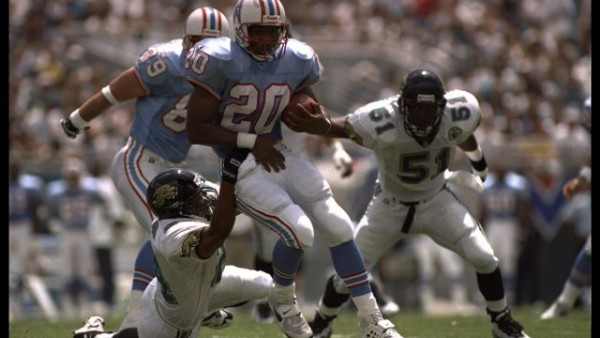 3 Sep 1995: Running back Rodney Thomas of the Houston Oilers is snagged by a Jacksonville Jaguar defender in Jacksonville, Florida. The Oilers defeated the Jaguars 10-3. Mandatory Credit: Doug Pensinger/Allsport