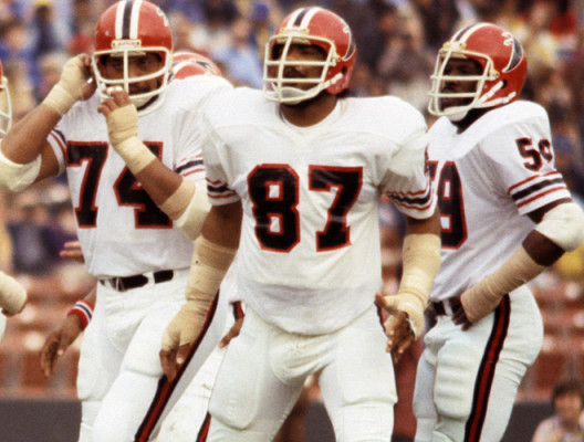 The Atlanta Falcons defense, including linebackers Greg Brezine (50). Ralph Ortega (55), and Robert Pennywell (59), and defensive linemen Jeff Merrow (75), Wilson Faumina (74), and Claude Humphrey (87), wait for the snap during a 23-7 loss to the Los Ange Atlanta Falcons vs Los Angeles Rams - December 11, 1977 (AP Photo/NFL Photos)
