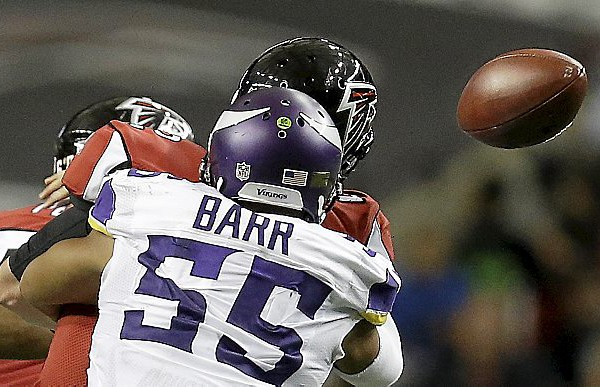 Minnesota Vikings outside linebacker Anthony Barr (55) causes Atlanta Falcons quarterback Matt Ryan (2) to fumble during the second half of an NFL football game, Sunday, Nov. 29, 2015, in Atlanta. Atlanta Falcons defensive tackle Ricky Heimuli recovered the ball. (AP Photo/David Goldman)