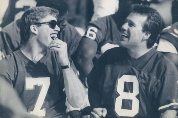JAN 27 1988 (GOS-209) San Diego, Calif., Jan. 26--Special to the Denver post -- Quarterbacks John Elway and Gary Kubiak laugh during picture day in San Diego, Tuesday. (AP LaserPhoto) c (pb1-31420-Damian Strohmeyer) 1988 Super Bowl Credit: AP