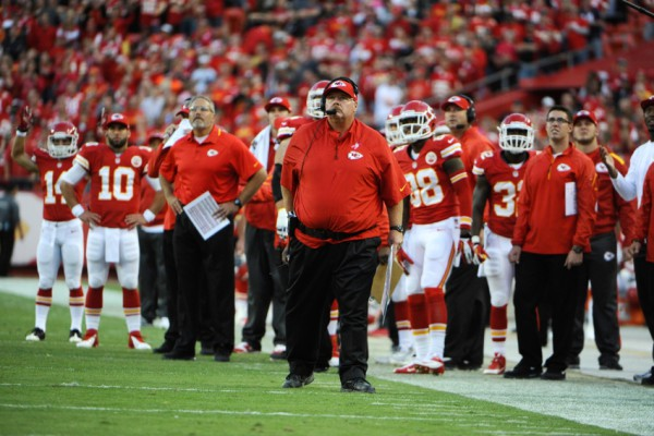 Oct 20, 2013; Kansas City, MO, USA; Kansas City Chiefs head coach Andy Reid (center) watches a replay against the Houston Texans in the second half at Arrowhead Stadium. The Chiefs won 17-16. Mandatory Credit: John Rieger-USA TODAY Sports