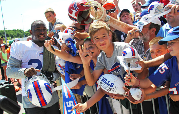 Buffalo Bills running back LeSean McCoy (25) poses with fans during their NFL football training camp in Pittsford, N.Y., Friday, July 31, 2015. (AP Photo/Bill Wippert)