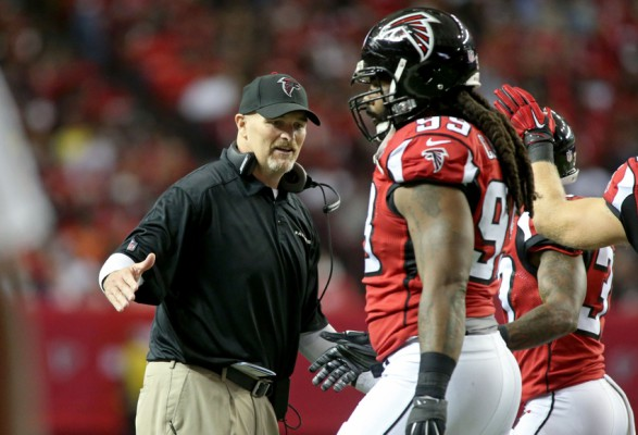 Nov 1, 2015; Atlanta, GA, USA; Atlanta Falcons head coach Dan Quinn (L) greets defensive end Adrian Clayborn (99) in the first quarter against the Tampa Bay Buccaneers at the Georgia Dome. Mandatory Credit: Jason Getz-USA TODAY Sports
