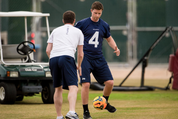 As the team warmed up for practice on Wednesday, kicker Steven Hauschka warmed up with a soccer drill.
