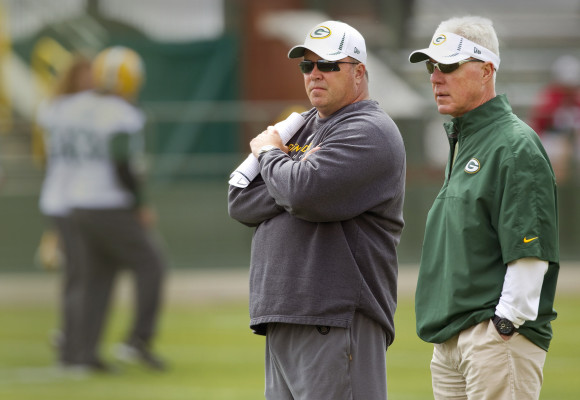 Green Bay Packers coach Mike McCarthy, left, and general manager Ted Thompson watch the NFL football team's minicamp Tuesday, June 12, 2012, in Green Bay, Wis. (AP Photo/Mike Roemer) ORG XMIT: WIMR103