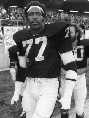 OAKLAND, CA - DECEMBER 29: Bubba Smith #77 of the Oakland Raiders looks on before the 1974 AFC Championship game against the Pittsburgh Steelers at the Oakland Alameda Coliseum on December 29, 1974 in Oakland, California. The Steelers defeated the Raiders 24-13. (Photo by Michael Zagaris/Getty Images)
