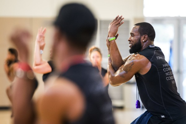"Seahawks strong safety Kam Chancellor stretches out with the rest of the group during a Form by Force Women's Boot Camp at the Gymnasium at Les Gove Park in Auburn on Wednesday, March 30, 2016. The Seahawks safety hosts the workouts, along with Kevin Allen, his personal trainer and co-owner of Form by Force. ""Special guests,"" like teammate Richard Sherman, sometimes make appearances."