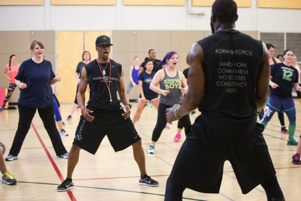 "Kevin Allen, facing, stands in line with participants as Kam Chancellor, right, helps lead exercises during a Form by Force Women's Boot Camp at the Gymnasium at Les Gove Park in Auburn on Wednesday, March 30, 2016. The Seahawks safety hosts the workouts, along with Kevin Allen, his personal trainer and co-owner of Form by Force. ""Special guests,"" like teammate Richard Sherman, sometimes make appearances."
