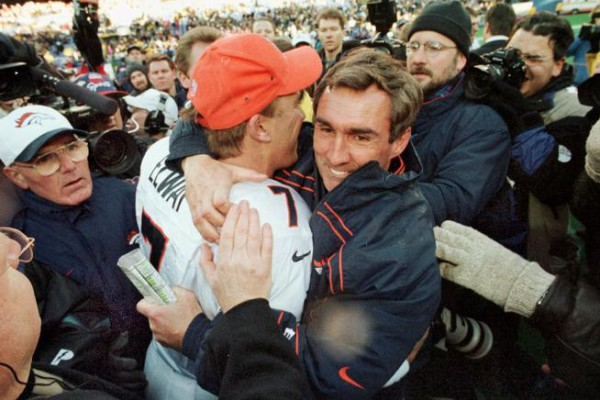 Caption: John Elway and Mike Shanahan celebrate the Broncos win over the Steelers 24-21 to win the AFC Championship game. Photographer: John Leyba Title: Staff Credit: The Denver Post City: Pittsburgh Date: 19980111 Keyword: PUBDATE____1998_01_12