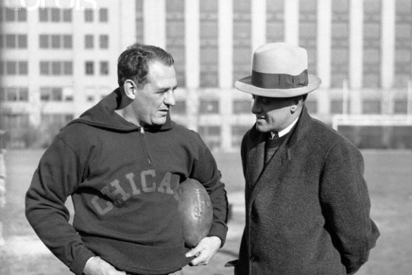 Original caption: Red grange, backfield star (left), and George Halas, coach and onwer of the Chicago Bears, are discussing the strategy to be used in the coming professional; championship match with the New York Giants. --- Image by © Bettmann/CORBIS