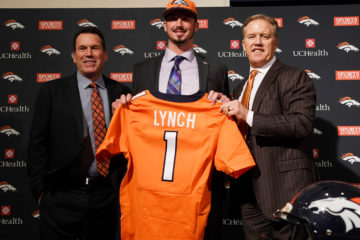 Denver Broncos head coach Gary Kubiak and executive vice president John Elway pose with first round pick QB Paxton Lynch during Lynch's introductory press conference at Broncos headquarters April 29, 2016. (Photo by Andy Cross/The Denver Post)