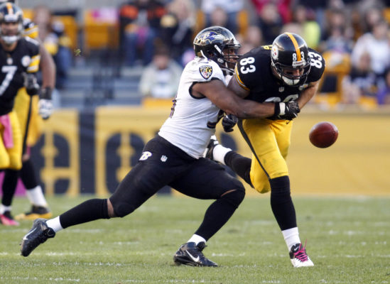 Oct 20, 2013; Pittsburgh, PA, USA; Baltimore Ravens inside linebacker Daryl Smith (left) causes Pittsburgh Steelers tight end Heath Miller (83) to fumble the ball during the second quarter at Heinz Field. Mandatory Credit: Charles LeClaire-USA TODAY Sports