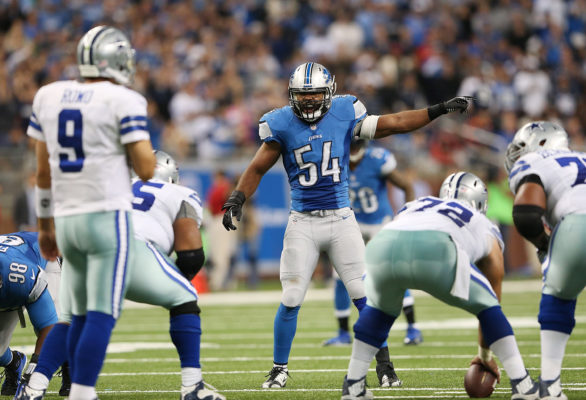 DETROIT, MI - OCTOBER 27: DeAndre Levy #54 of the Detroit Lions checks the offense call during the fourth quarter of the game against the Dallas Cowboys at Ford Field on October 27, 2013 in Detroit, Michigan. The Lions defeated the Cowboys 31-30. (Photo by Leon Halip/Getty Images)