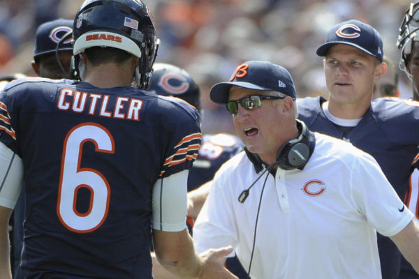 Chicago Bears head coach John Fox celebrates a touchdown with quarterback Jay Cutler (6) during the first half of an NFL football game against the Arizona Cardinals, Sunday, Sept. 20, 2015, in Chicago. (AP Photo/David Banks)